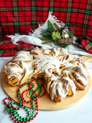 Cinnamon Snowflake break is filled with cinnamon and sugar and topped with a cinnamon icing.