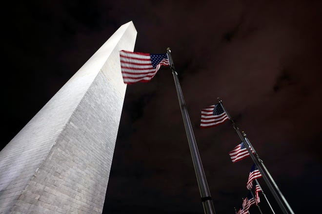 American flags fly around the Washington Monument, which was temporarily closed last week because of a recent visit by Interior Secretary David Bernhardt, who tested positive for the coronavirus on Wednesday, shortly after conducting a private tour of the monument.