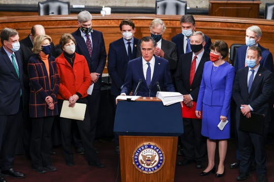 Sen. Mitt Romney (R-UT) speaks alongside a bipartisan group of members of Congress as they announce a proposal for a Covid-19 relief bill on Capitol Hill on December 14, 2020 in Washington, DC. Lawmakers from both chambers released a $908 billion package Monday, split into two bills.