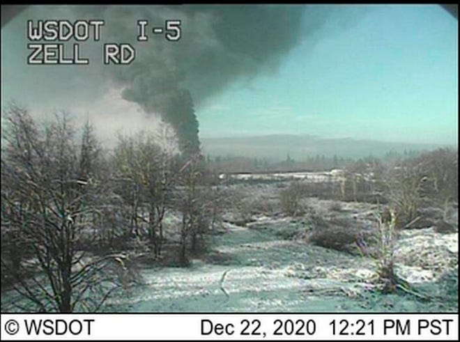 A Washington state Department of Transportation traffic camera captures an image of a train that derailed on Tuesday north of Seattle, near the Canadian border.