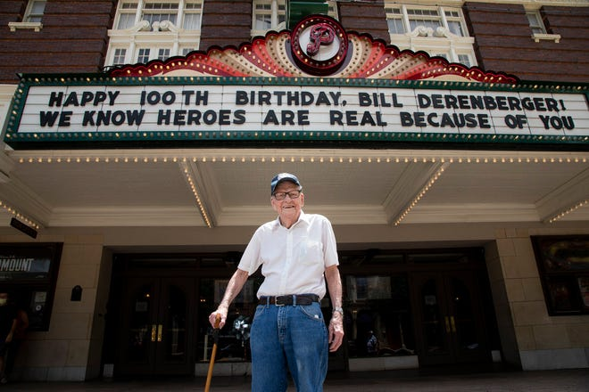 Bill Derenberger stands in front of the Paramount Theatre on his 100th birthday on July 26.