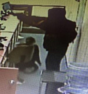 Austin police are looking for two men who authorities say held up and tried to rob a pharmacy in September.