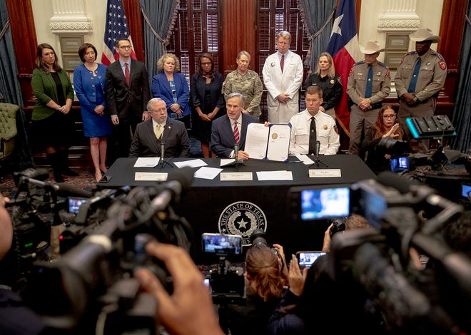In Austin, Gov. Greg Abbott issues a disaster declaration for Texas on March 13, 2020, in response to the growing threat of the coronavirus.