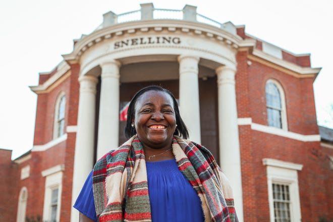 Sandra Patterson, better known as Miss Sandra, poses for a photo in front of UGA's Snelling Dining Hall in Athens, Ga., on Wednesday, Dec. 23, 2020. Patterson recently retired after 33 years of working for the university.