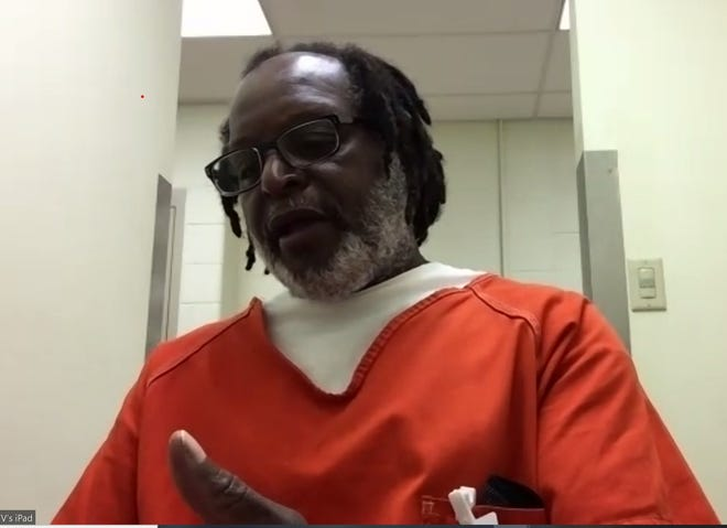 Stanley Ford, an Akron man accused of nine arson deaths, speaks during a 2020 video hearing in Summit County Common Pleas Court.