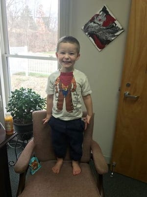 Hinckley police say Tony, apparently abandoned Dec. 23 at Hope Memorial Gardens Cemetery, has been reunited with his father. His mother may face charges, said Police Chief David Centner.