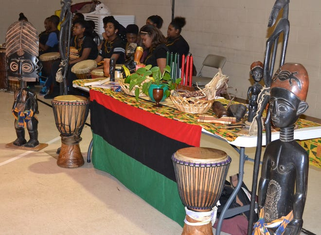 "A Kwanzaa table featuring the traditional candle set known as the kinara as well as other symbols of African heritage is shown during a past ""Kujichagulia"" celebration at Mount Calvary Baptist Church in Akron."