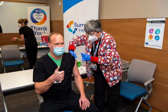 Summa Health nurse Jesse Gabele receives a COVID-19 vaccine Dec. 23.