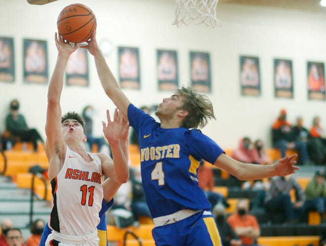 Wooster's Brayden Hamilton (4) blocks a layup attempt from Ashland High's Eli White (11) during the Generals' 78-75 victory on Tuesday night at Arrow Arena.