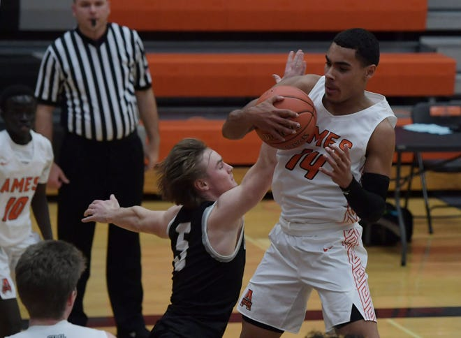 Tamin Lipsey, seen here playing against Ankeny Centennial in December, scored 20 points in a losing effort for the No. 6 (4A) Ames boys in a 37-35 loss at Dowling Catholic Saturday in West Des Moines.