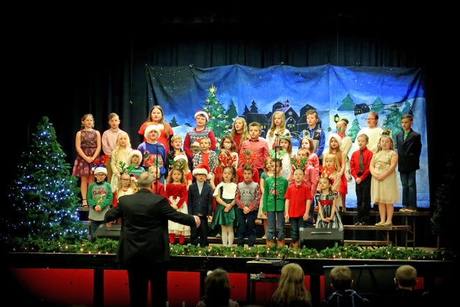 "Prairie Home kindergarten through third-grade students perform ""We Wish You a Merry Christmas"" on Dec. 15 as part of the Prairie Home Music Department's Christmas program."