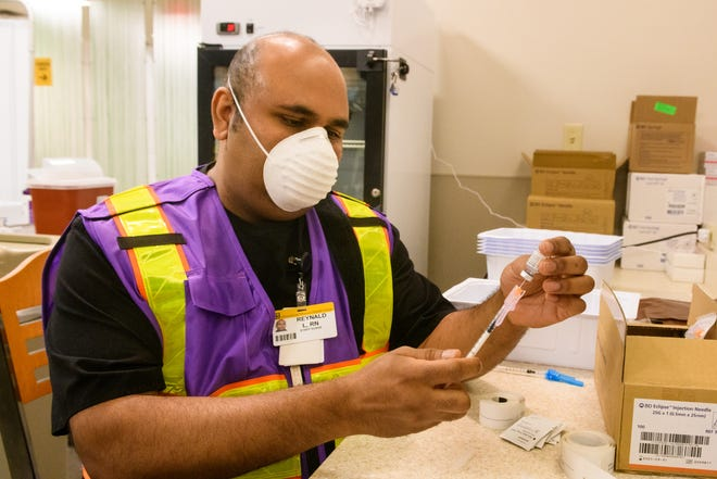 MU Health Care staff nurse Rey Lachhman draws up COVID-19 vaccinations Dec. 16, 2020 at University Hospital in Columbia.