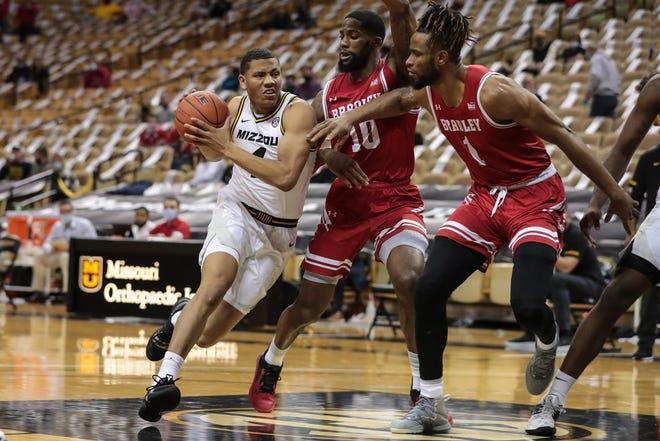 Mizzou guard Javon Pickett (4) drives the ball against Bradley at Mizzou Arena last Tuesday.