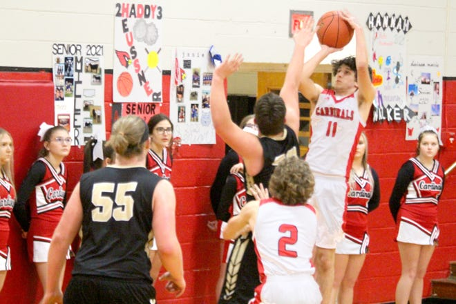 Drake Heussner of the Hale/Bosworth Cardinals hits a third-period jumper from the right baseline during the Cardinals' 67-25 home win over Norborne Tuesday (Dec. 22, 2020).