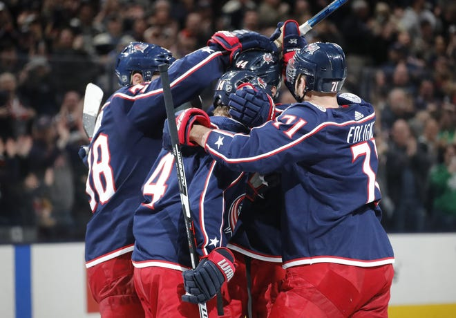 The Blue Jackets celebrate an empty-net goal against the Vancouver Canucks on March 1.
