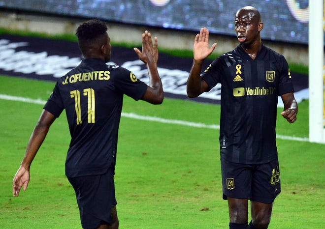 Bradley Wright-Phillips, right, shown with Los Angeles FC teammate Jose Cifuentes, scored eight goals with six assists in 18 games for LAFC in the 2020 season.