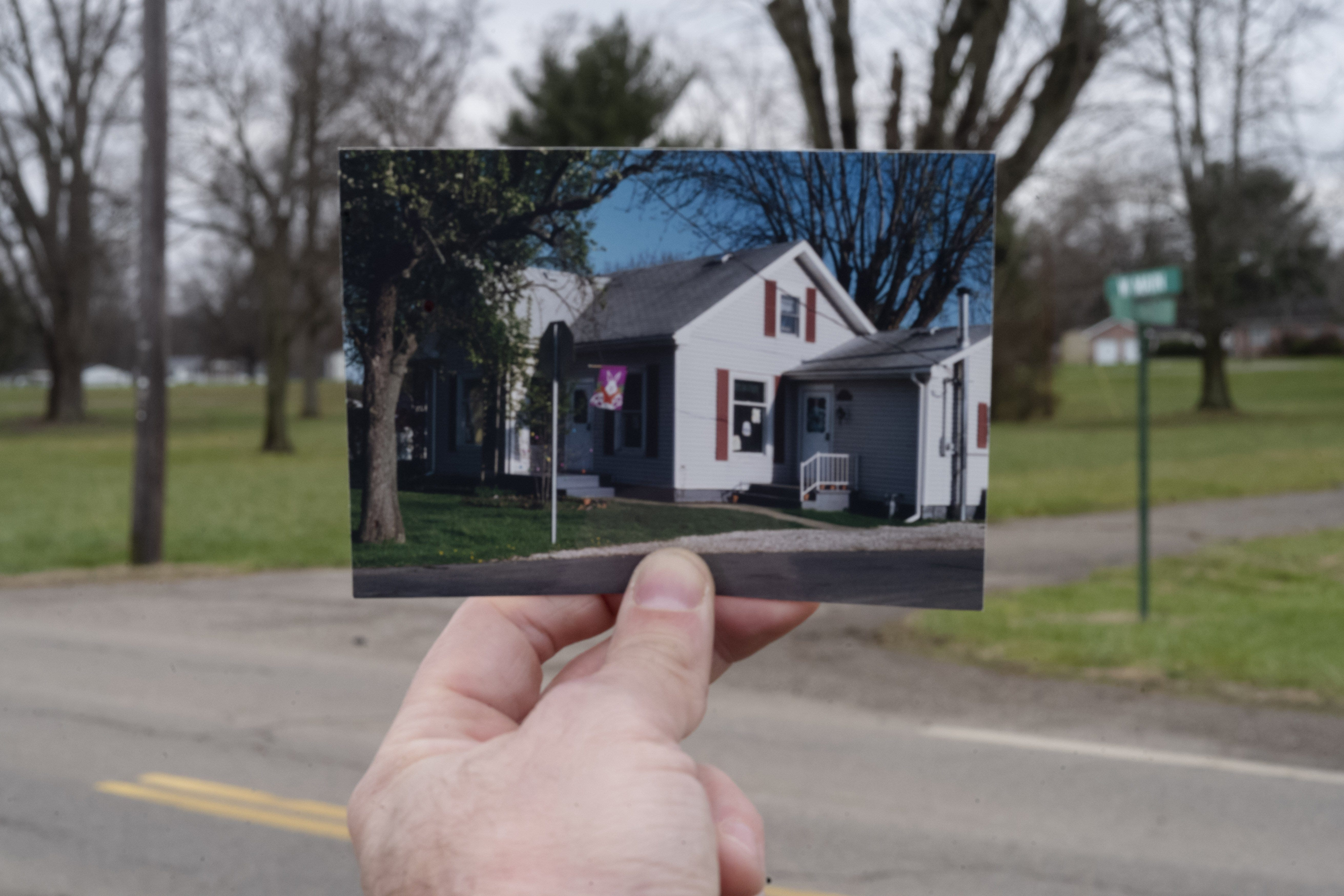 A photograph of Jennifer Harrison's former home at 201 St. Rt. 554 seen at the present day intersection of St. Rt. 554 and Fourth St., on Monday, Dec. 21, 2020 in Cheshire, Ohio.