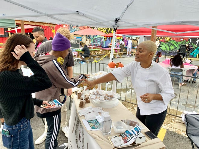 Breanna Bolden, alumna of the Chef John Folse Culinary Institute at Nicholls State University and owner of Oven Bits and Pieces, offers samples of her creations at a recent fair in New Orleans.
