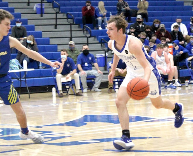 Cambridge's Caleb Bond (1) brings the ball up-court during Tuesday evening's game with Maysville inside Gene Ford Gymnasium.