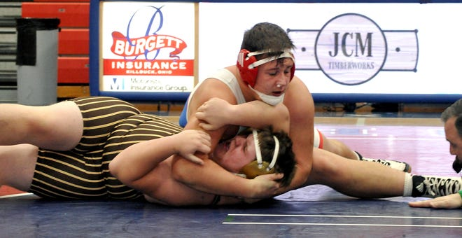 West Holmes' Collin Gardner pins Waynedale Zach Gumber in a heavyweight matchup during the Knights' dual win.