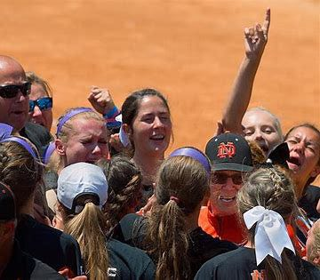 North Davidson softball coach Mike Lambros celebrates with his team after winning the 2017 4-A state championship on June 3, 2017. Lambros passed away on Sept. 29, 2017 due to pancreatic cancer. (Donnie Roberts/The Dispatch)