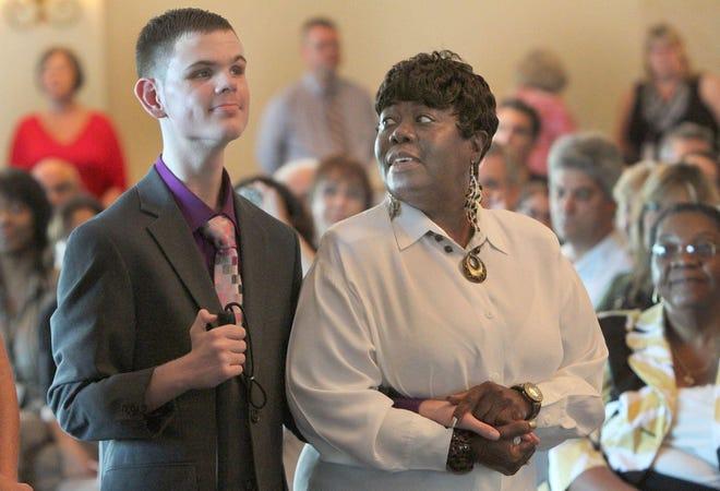 Joyce Slusher of Palm Coast, adopted  Anthony, 14, in 2013.
