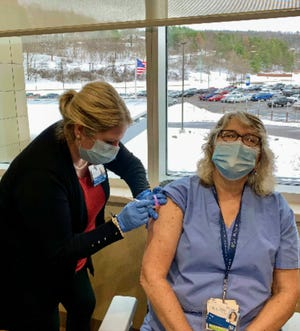 Pegg Mitchell, RN (right), was the first employee to be vaccinated at the St. James COVID-19 vaccine clinics in Hornell. SJH chief nursing officer, Melissa Rackmil, administered the vaccine.