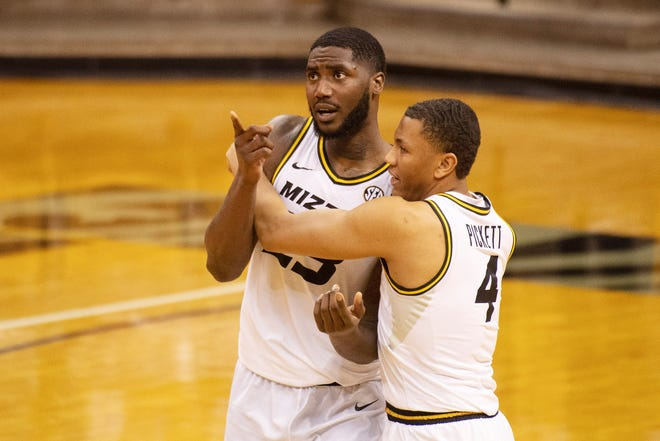 Missouri's Jeremiah Tilmon, left, is embraced by teammate Javon Pickett, right, after defeating Bradley 54-53 on Tilmon's three-point play with 1 second left.