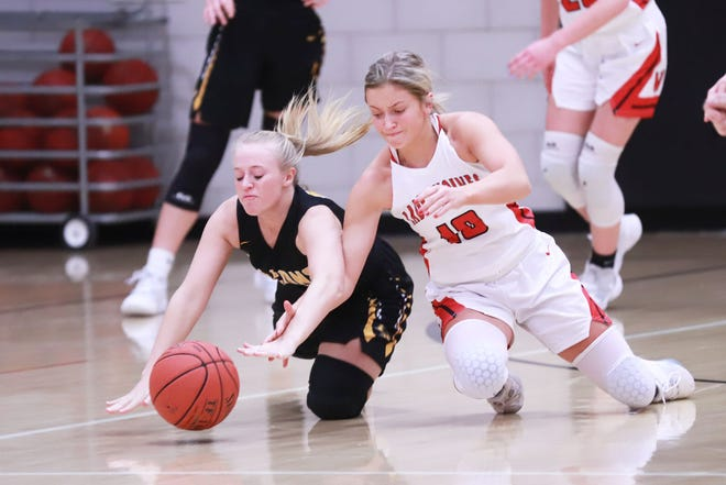 Winfield-Mt. Union's Jami Wilkerson and Louisa-Muscatin'es Emily Truitt go after a loose ball in the Wolves' win at home.