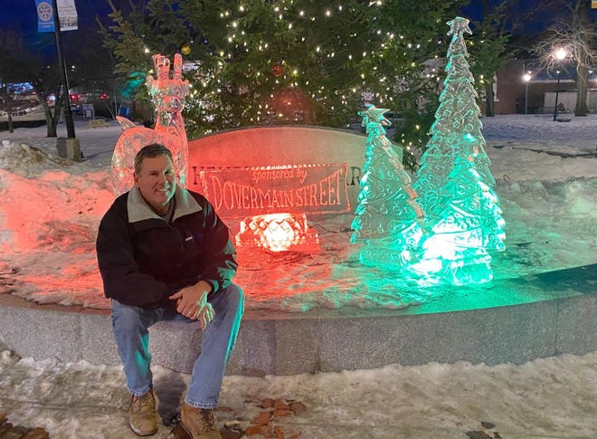 Steve Piper, executive board member of Dover Main Street, with the all-volunteer group's 2020 holiday season ice sculpture.