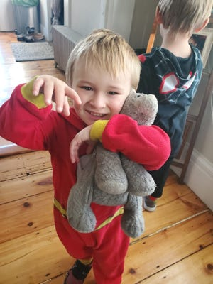 Jaymison Dube, 3, holds his beloved stuffed cat Slippers Wednesday morning not long after his mother Sara Flowers found the lost toy on the Dover Community Trail. Jaymison, who has autism, had been having a difficult time ever since he lost Slippers on the trail on Nov. 14.