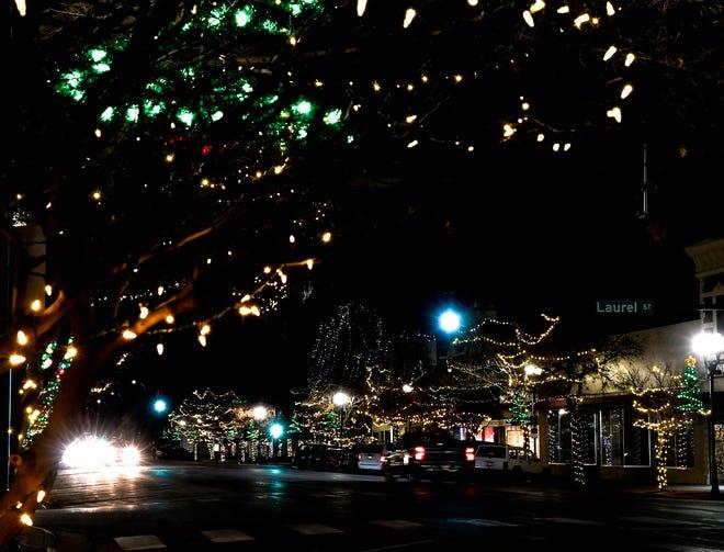 Motorists make their way along Main Street through an array of lights decorating trees in downtown Garden City. [BRAD NADING/GARDN CITY TELEGRAM]