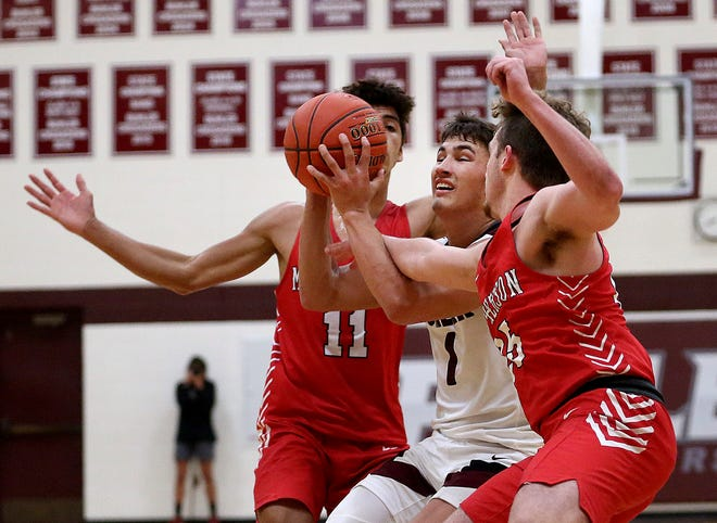 McPherson's Jayden Dukes (11) left, scored eight points in the team's loss at Derby. [FILE PHOTO]