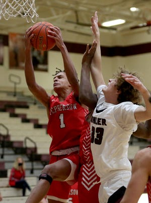 Trey Buckbee (1) scored eight points for the Bullpups in their McPherson Invitational Tournament opener, a loss to Manhattan. The team will be back in action at the roundhouse Thursday agains Shawnee Heights, who lost to Maize South 52-29 Jan. 18. [FILE PHOTO]