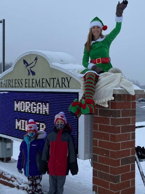 Sara Amato, a fourth-grade intervention specialist at Fairless Elementary School, donned an elf outfit and greeted students as they came to school last week.  Carson and Camdyn Owen decided to snap a picture with the elf.