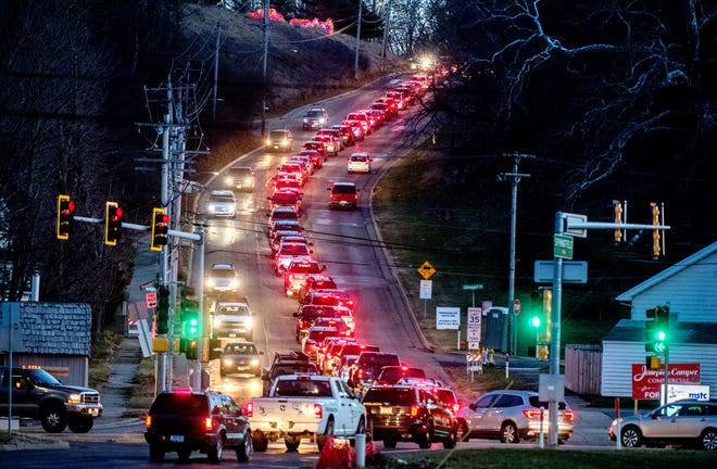 The nightly Winter Wonderland traffic jam starts to form Tuesday, Dec. 22, 2020 at the intersection of Springfield Road and E. Washington Street in East Peoria.