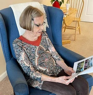 """Kit Baldwin looks through the book she wrote entitled """"Through the Eyes of Love"""" at her home in Freeport."""