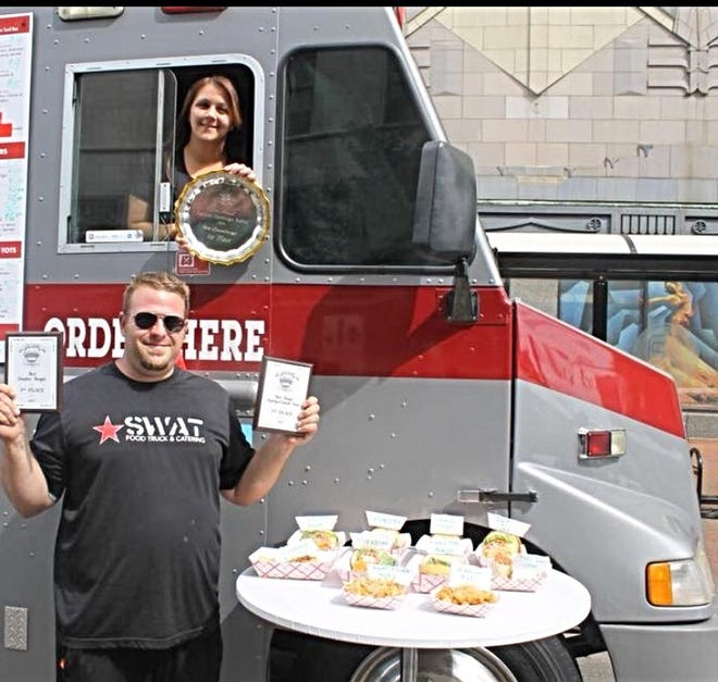 Felicia Korth and Daniel Molnar stand with the SWAT Food Truck.