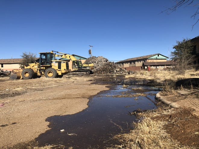 Lubbock's former Ponderosa Apartments and Spanish Oaks Apartments were nearing demolition Tuesday after the City Council last week approved funding to demolish the burned or abandoned structures.