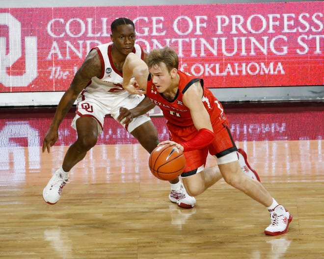 Texas Tech's Mac McClung (0) drives past Oklahoma's Umoja Gibson during the second half of a Big 12 Conference game Tuesday at the Lloyd Noble Center in Norman, Okla. McClung scored six of his 16 total points in the final 30 seconds to help the No. 15 Red Raiders down the Sooners 69-67.