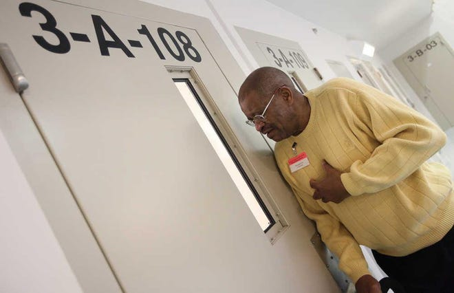 Former Lubbock City Councilman T.J. Patterson visits with inmates at the Lubbock County Detention Center in 2010 as part of his annual tradition of sharing a positive message on Christmas Day.
