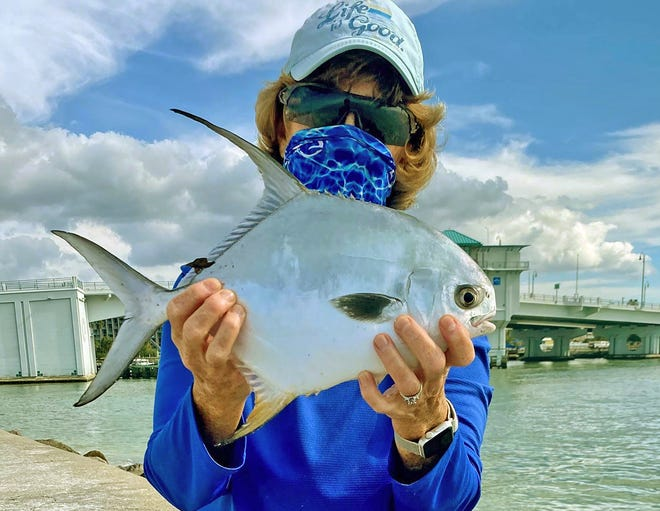 Eileen Kivlin of Halfmoon, New York, caught this 16-inch permit while fishing from the jetty at John's Pass in Madeira Beach last week.