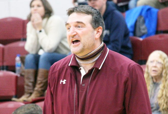 Eldon boys basketball coach Cory Casey gives his team directions in a game against Eugene on December 22 in Eldon.