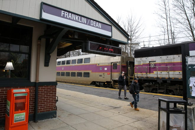 Keolis has cut the number of weekday commuter rail trains it runs from 541 to 246. [Daily News file photo]