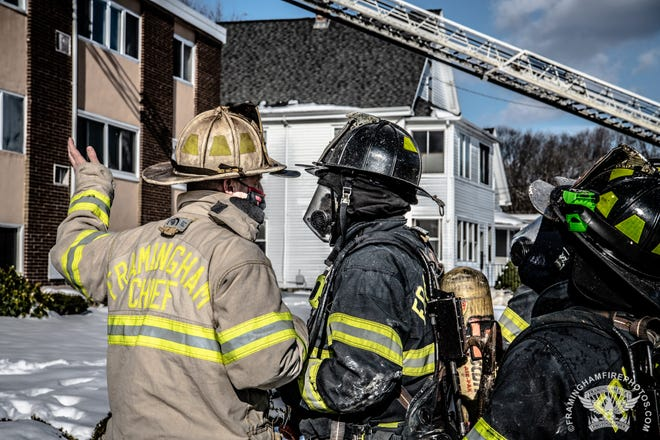 Framingham Fire Chief Michael Dutcher gives instructions at the scene of a fire Tuesday, Dec. 22, 2020, on Willis Street.