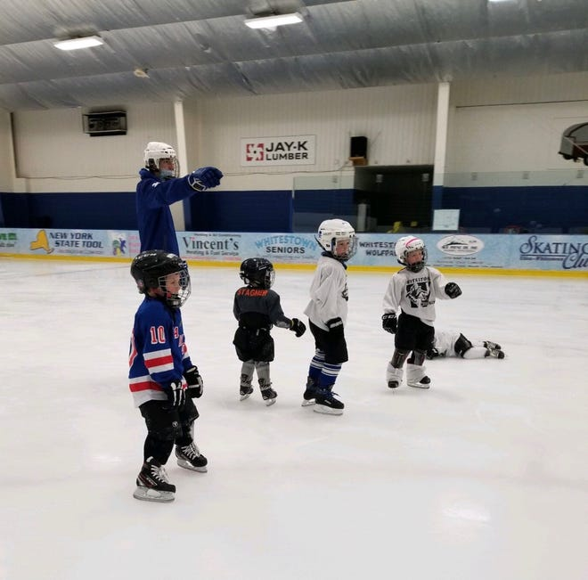Whitesboro boys hockey players helps young children at the Learn to Skate program twice a week at the Whitestown Community Center.