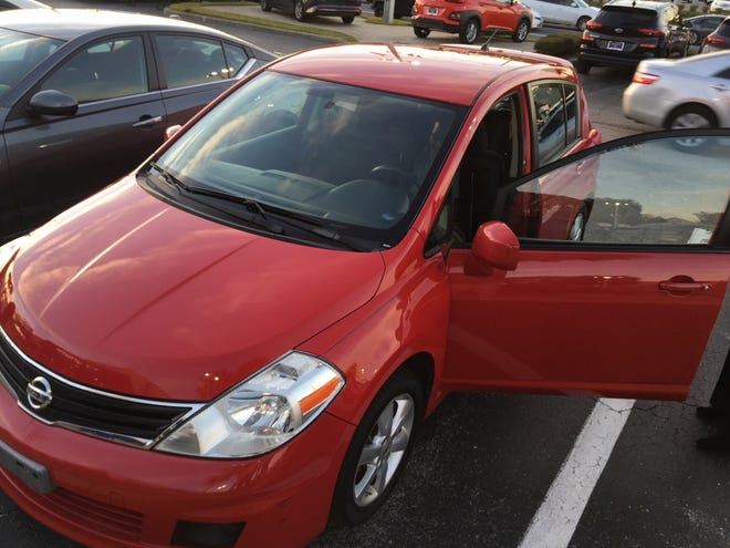 Eleazar Quetant sits in his new car, courtesy of Jenkins Auto Group.