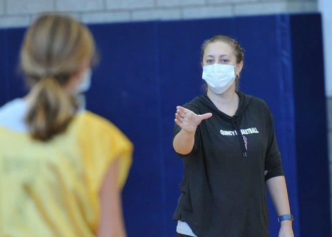 Quincy High School's new girls varsity basketball coach Sarah Conlon instructs her team during practice, Tuesday, Dec. 22, 2020.