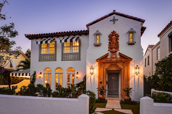 A major restoration project and renovation restored the elaborate coral-colored frontispiece surrounding the front door of a landmarked house at 212 Seaspray Ave, which recently sold for a recorded $6.235 million in Palm Beach.