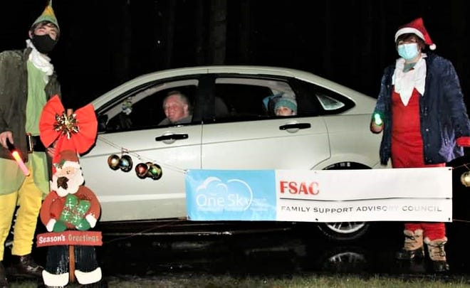Elves great the Phaneuf family during the One Sky Community Services holiday drive-thru event earlier this month.